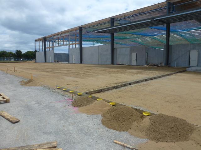 A yard is prepared to receive fibre concrete pour