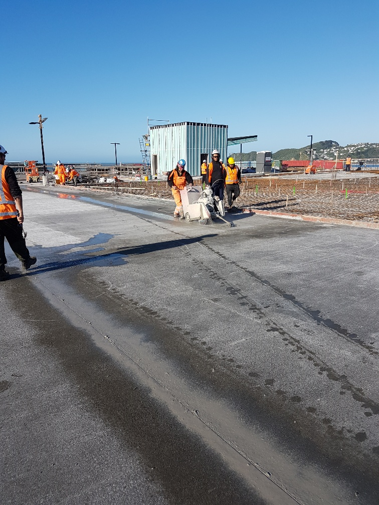 Workers prepare a concrete slab