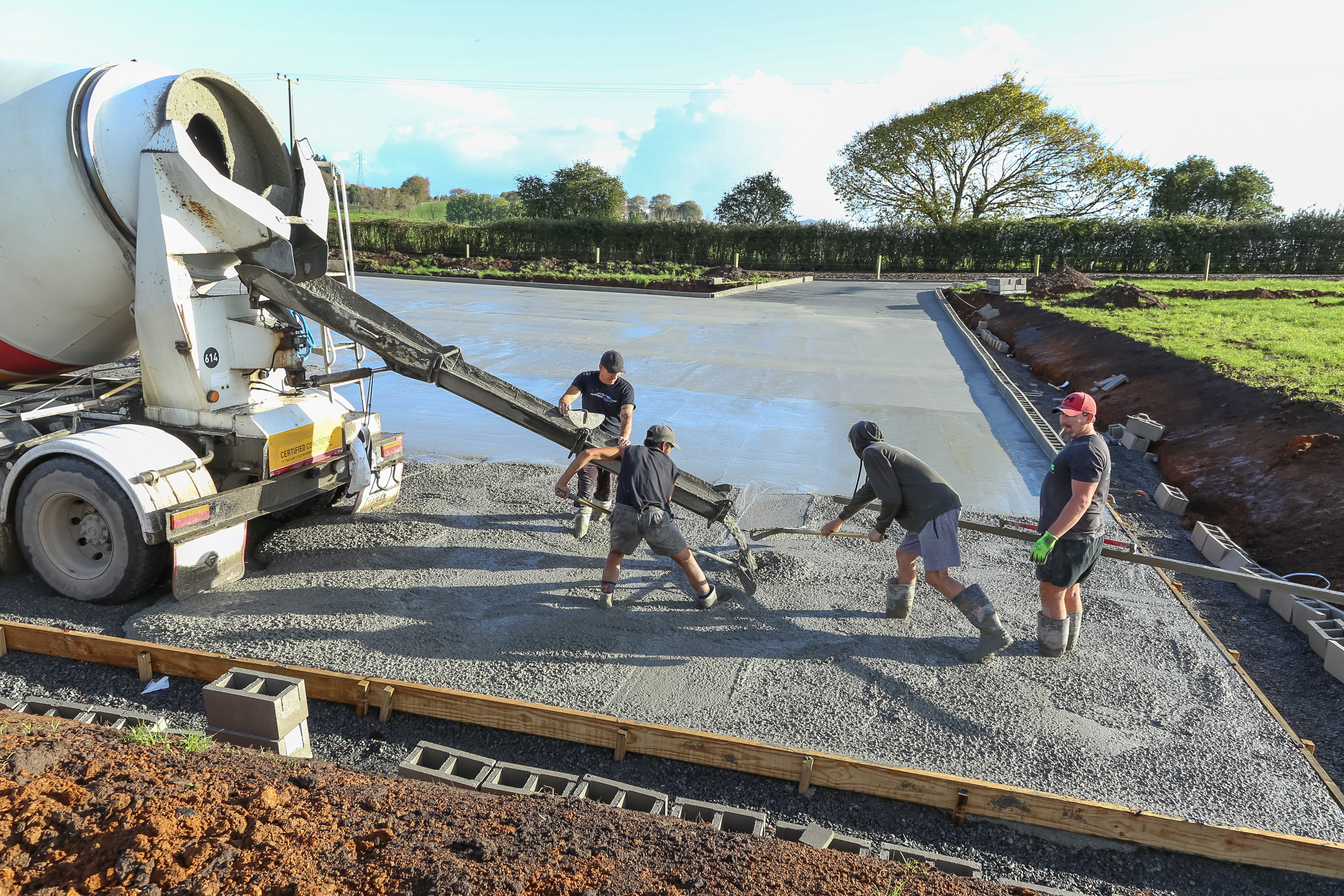 Concrete with Radforce is placed into forms for a large outdoor slab