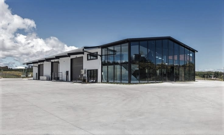 A large fibre cement yard surrounds an attractive industrial complex that is built on an Inforce permaforce steel cold drawn fibre cement slab