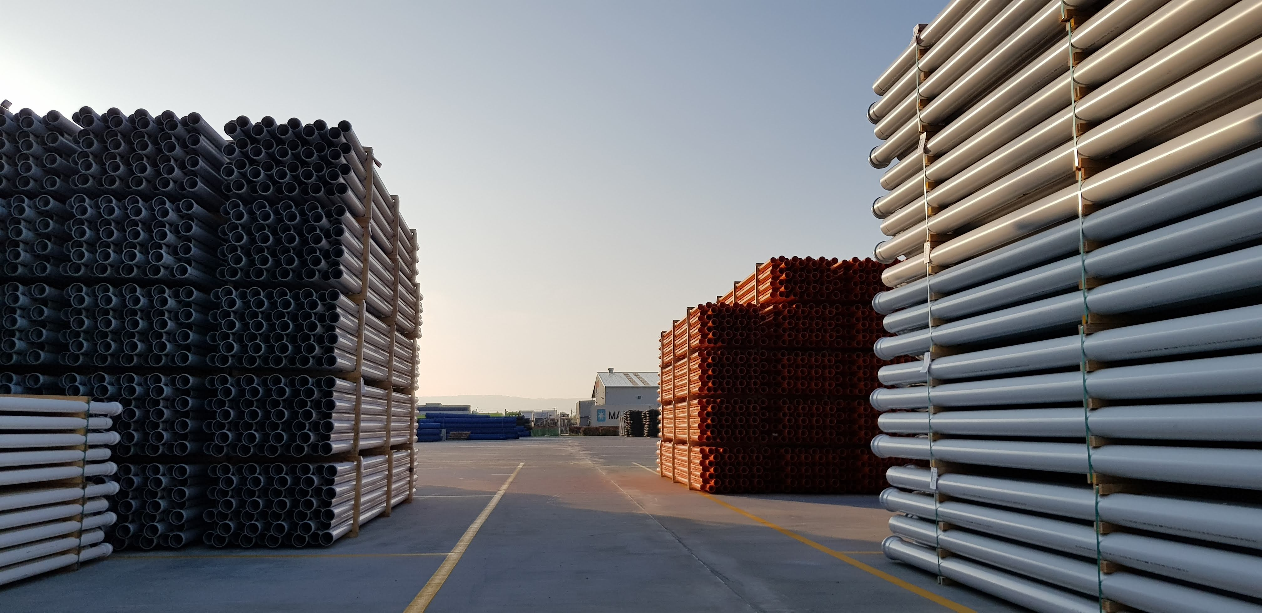 Permaforce fibre reinforced concrete slab easily handles large heavy stacks of pipes in this industrial loading bay