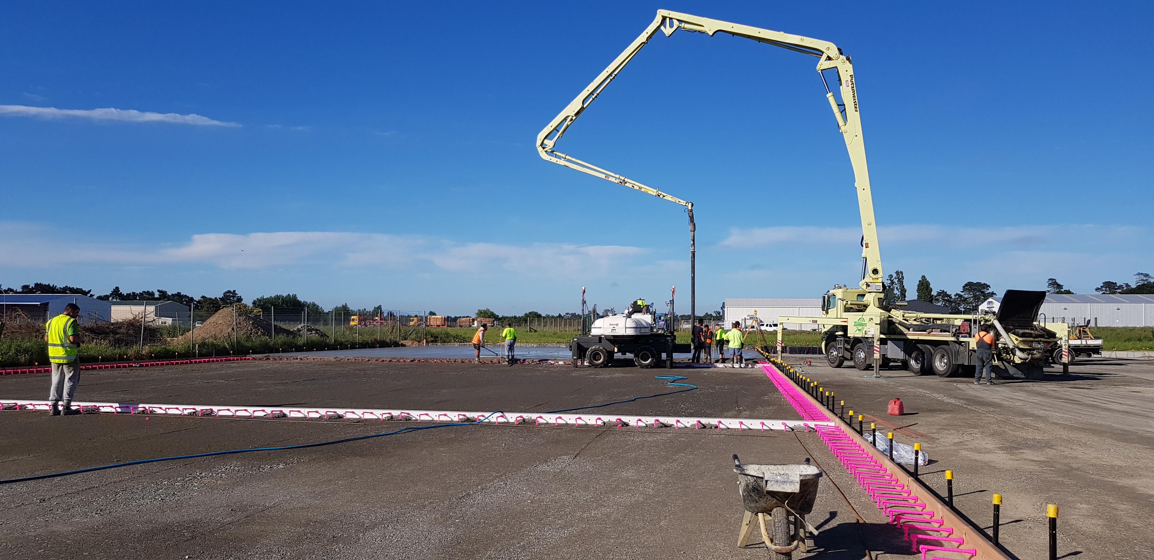 Concrete truck placing fibre concrete on building site
